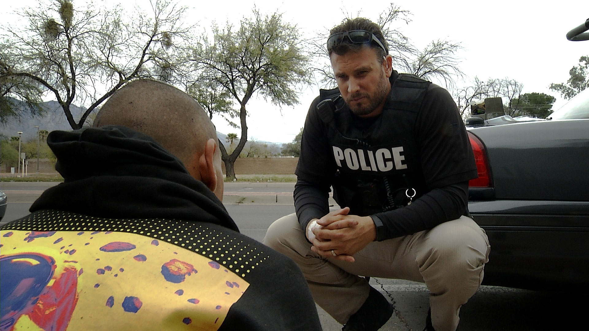 Tucson Police officer Chris Ciarvella speaks to a man about the department's Deflection Program that allows officers to take people to treatment for drug-related crimes instead of arresting them. On March 10, 2020, Ciarvella stopped the man while responding to a shoplifting call and discovered he had drug paraphernalia. The man accepted the offer to enroll in treatment.