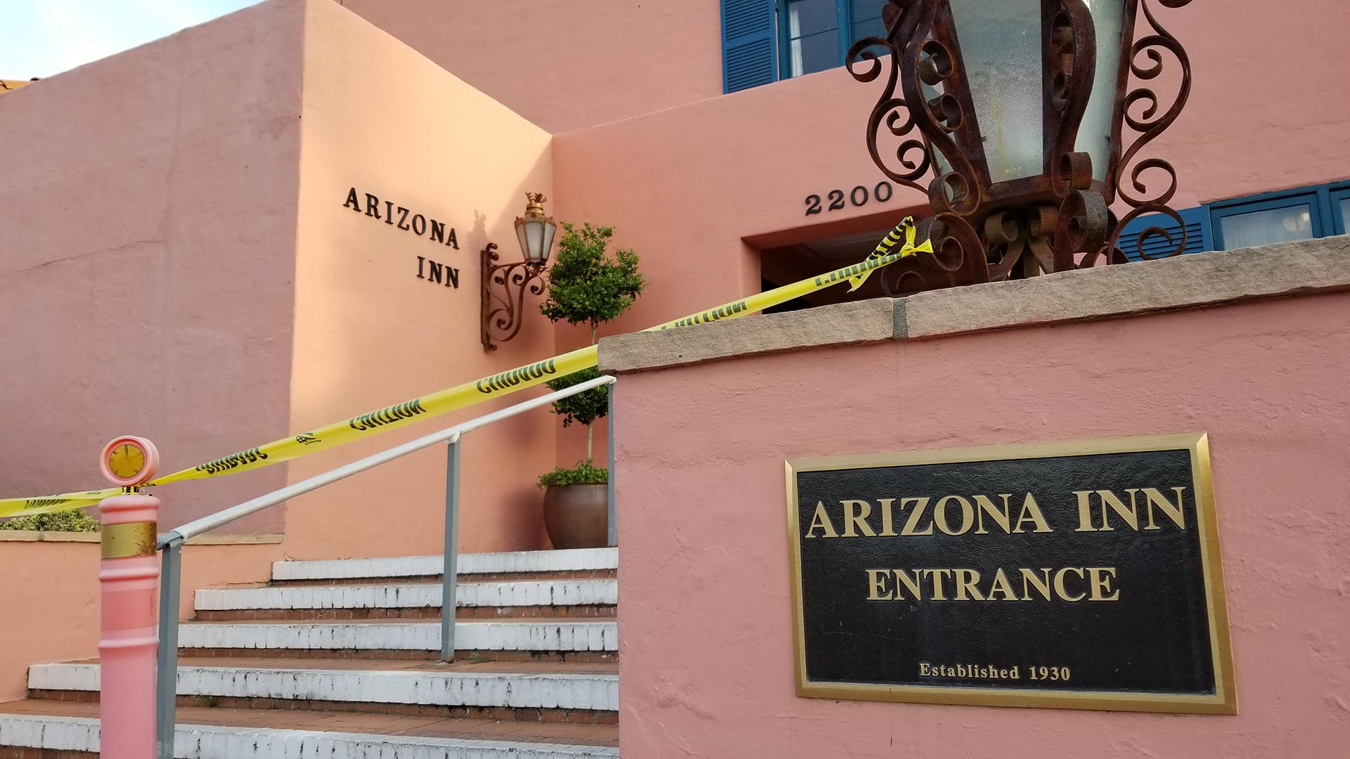Yellow caution tape blocks the entrance to the Arizona Inn, which has temporarily closed as a precautionary measure against coronavirus. From March 16, 2020.