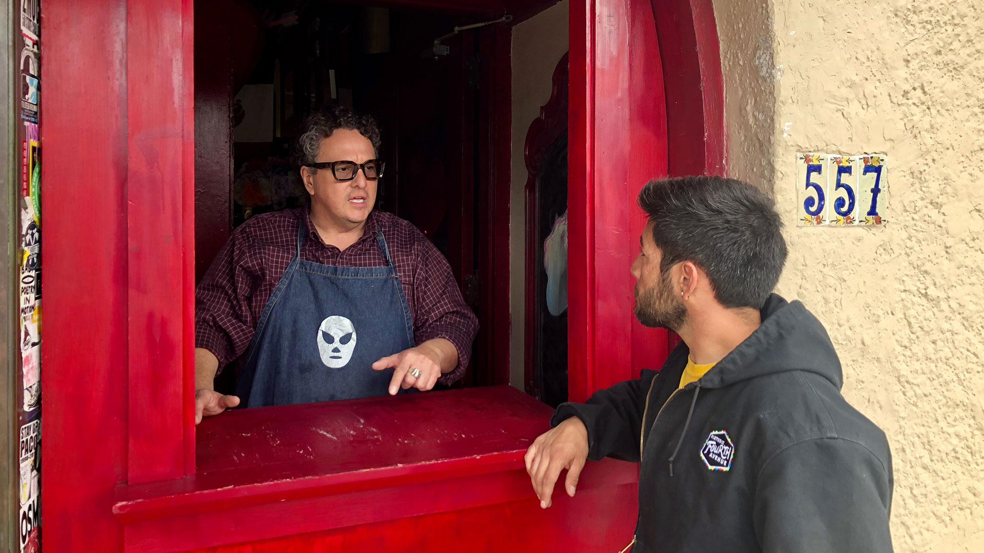 Martin Fontes installs a take out window in the doorway of Martin's Comida Chingona on March 18, 2020.