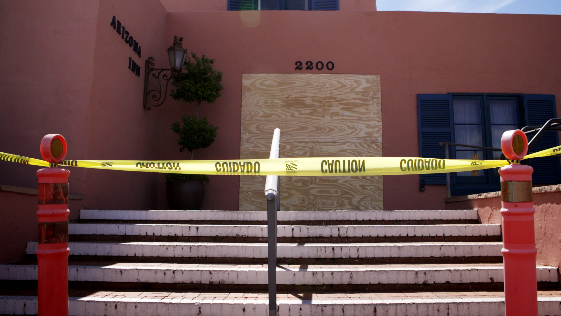 Caution tape and plywood block the entrance to the Arizona Inn which closed as a precaution over COVID-19 pandemic concerns.