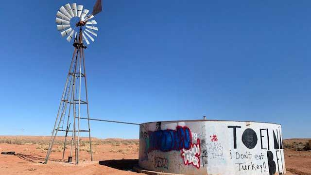 Many Navajo haul non-potable water from windmills like this one for their sheep and to do the washing.