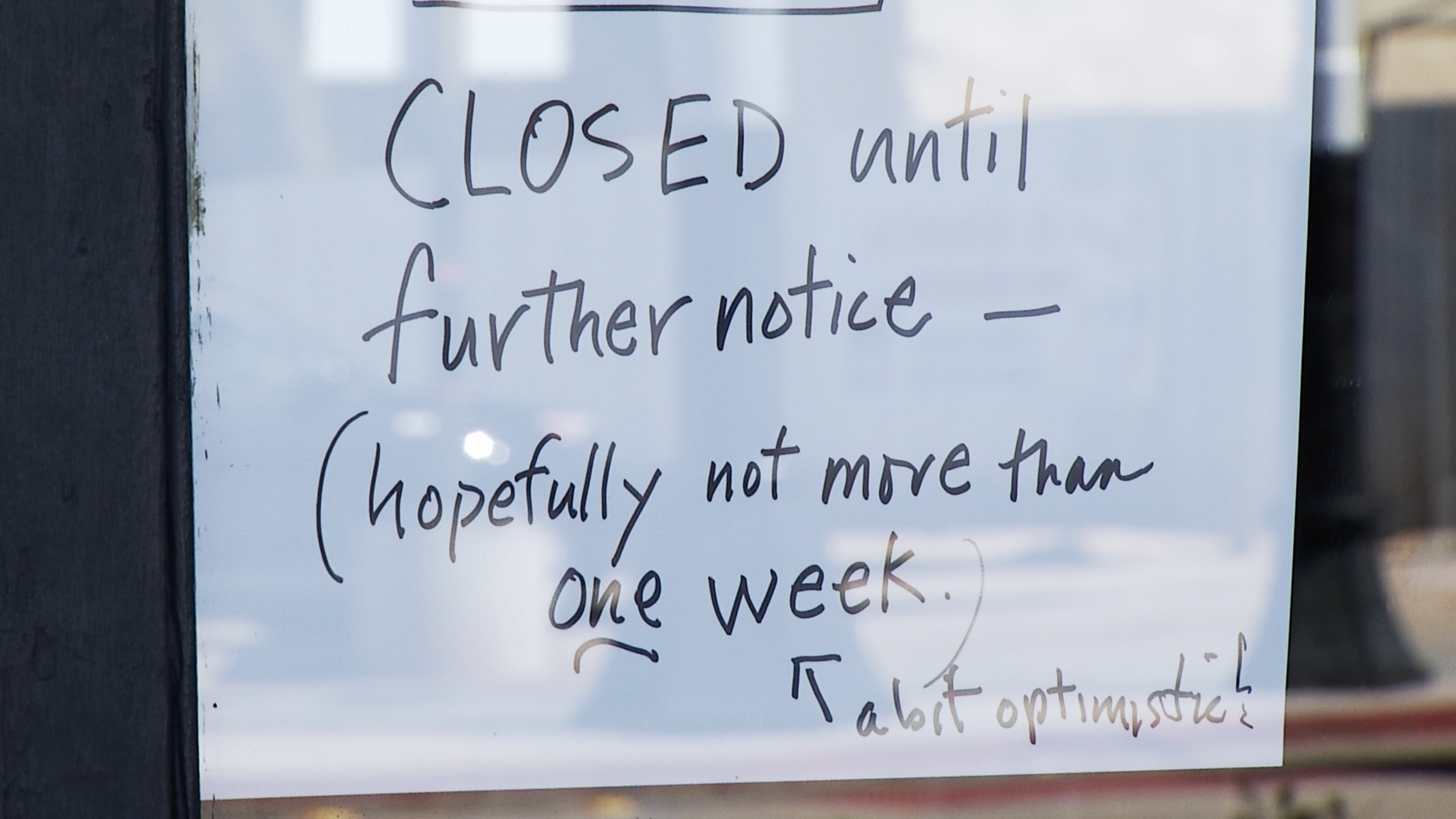 A hand-written sign posted by a business on 4th Avenue about the store's closure as a result of the COVID-19 pandemic.