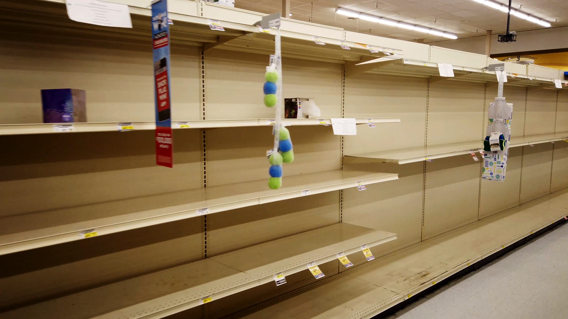 Shelves at a grocery store in Tucson are bare as demand has increased for certain items as a result of the coronavirus pandemic.