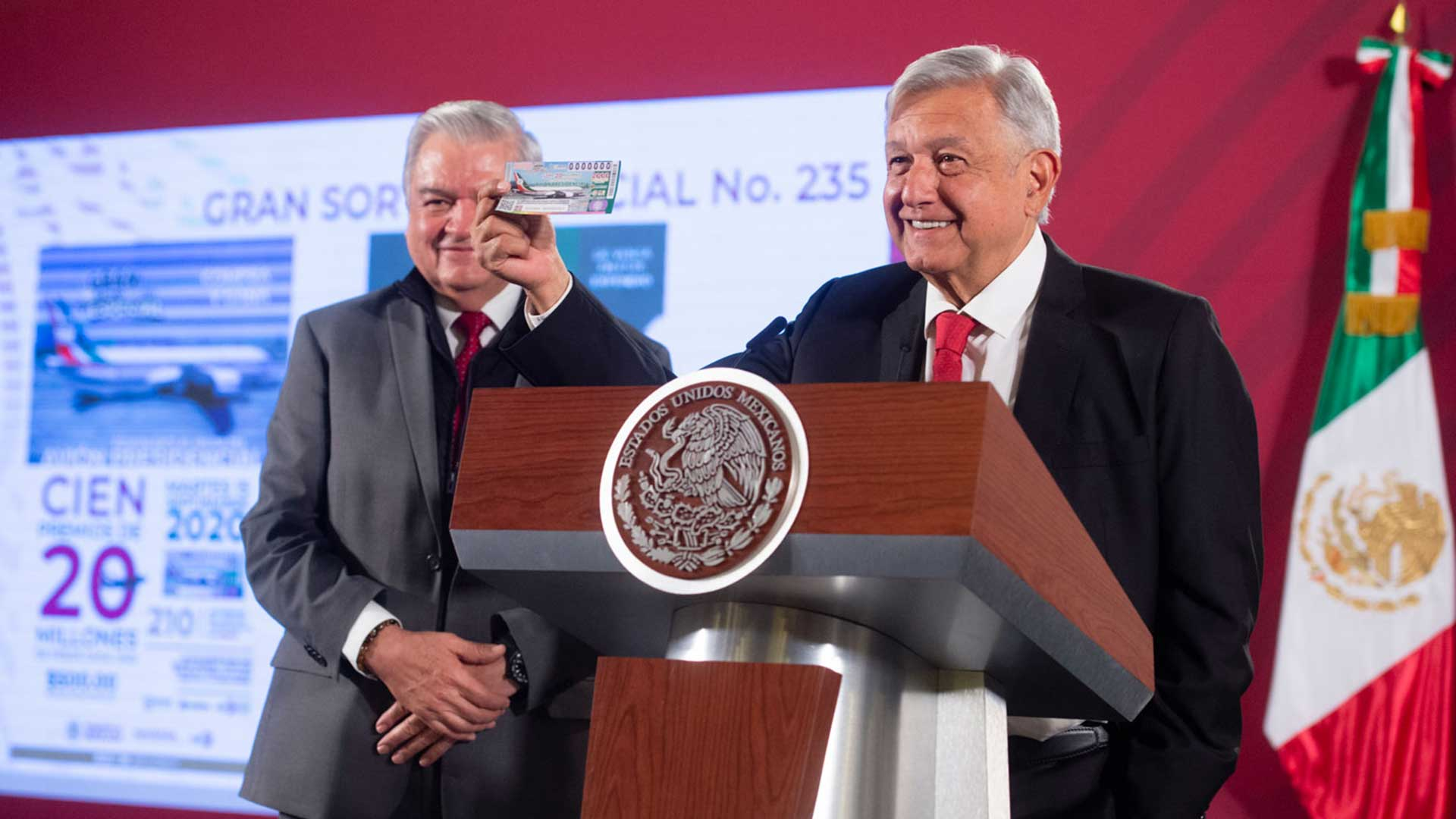 Mexican President Andrés Manuel López Obrador shows the ticket he purchased for the presidential airplane raffle.