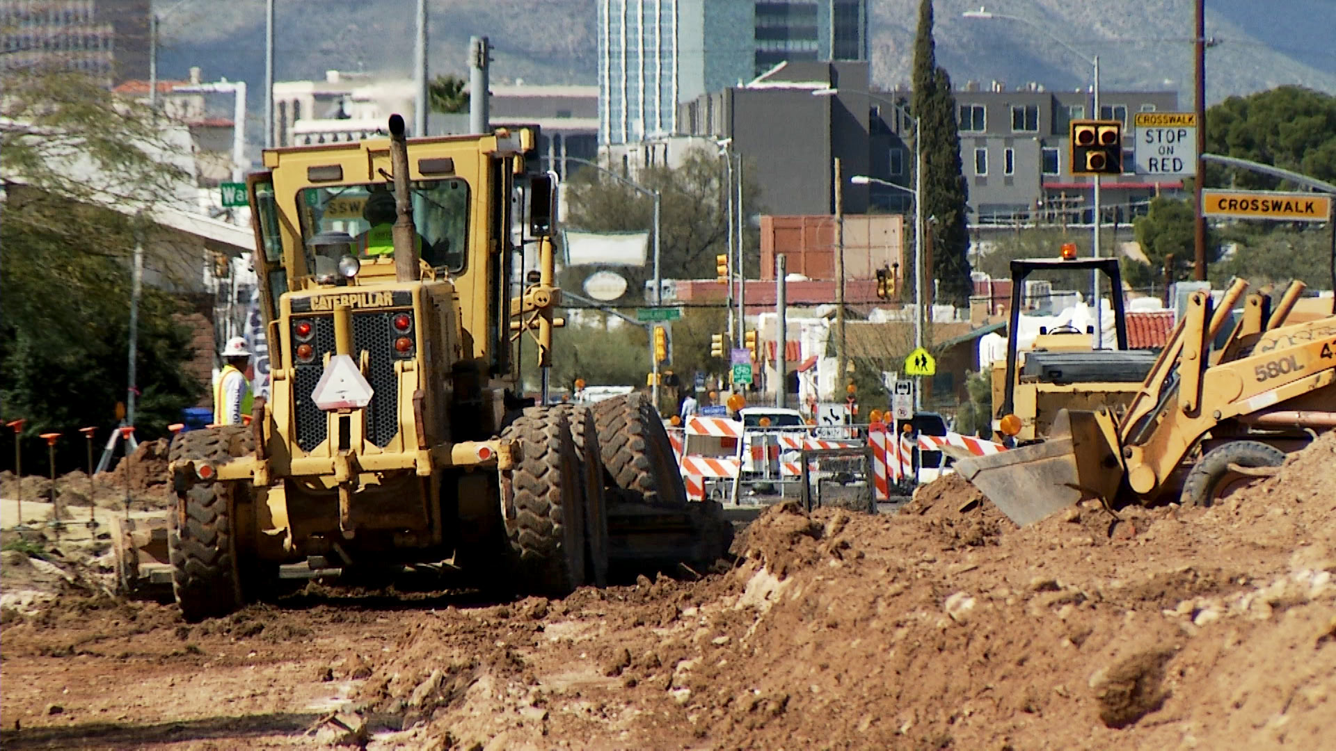 Construction crews work to widen Broadway Boulevard east of Euclid Avenue in Tucson on March 2, 2020.