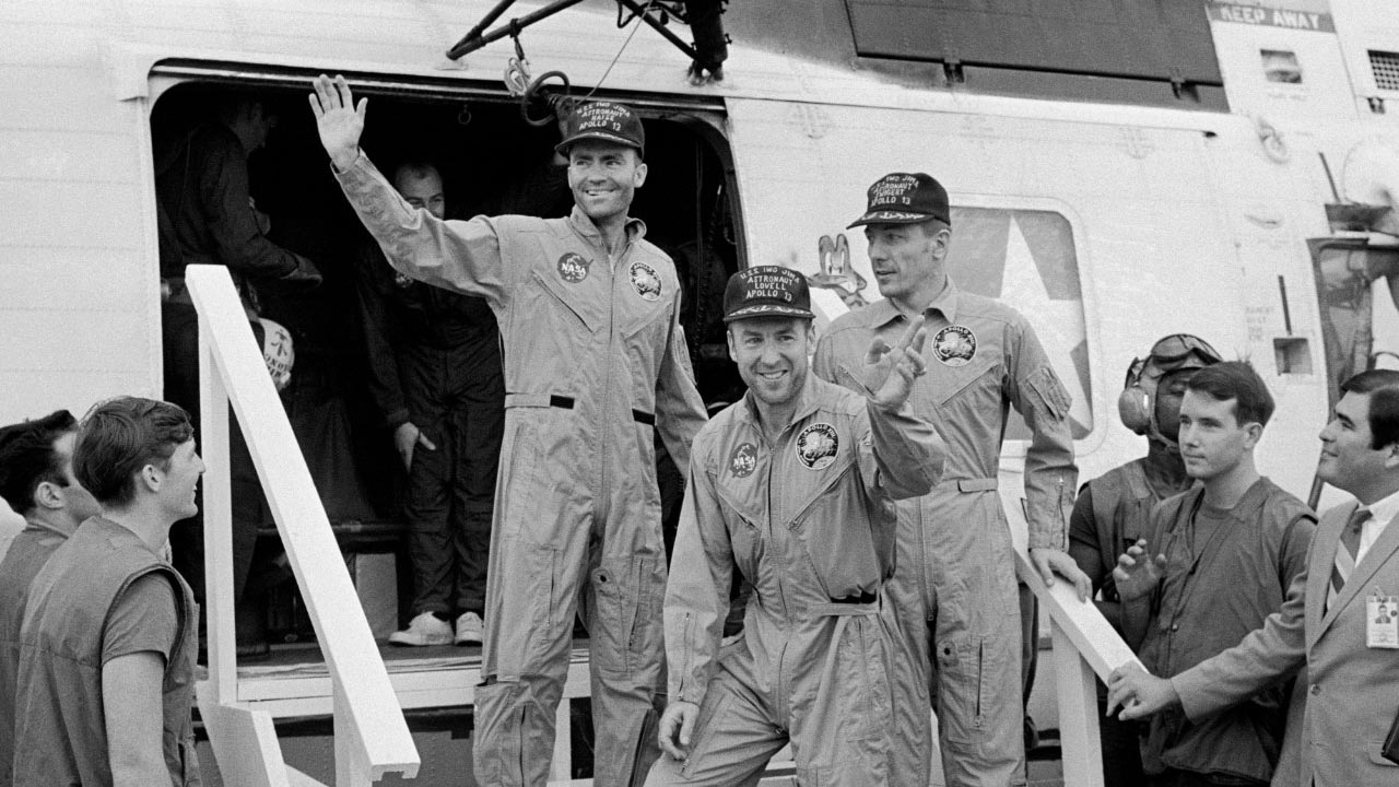 NASA astronauts (from left), Fred Haise, Jim Lovell and Jack Swigert aboard the U. S. aircraft carrier Iwo Jima April 17, 1970.