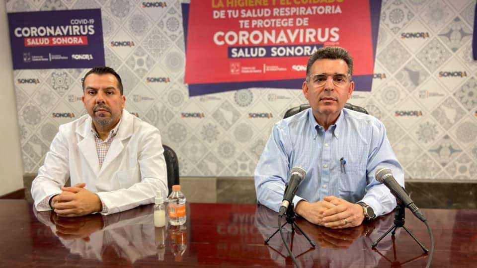 Sonora Health Secretary Enrique Clausen, right, announces the implementation of the second phase of the state's stay-at-home measures, which strictly prohibits movement except for six essential reasons.