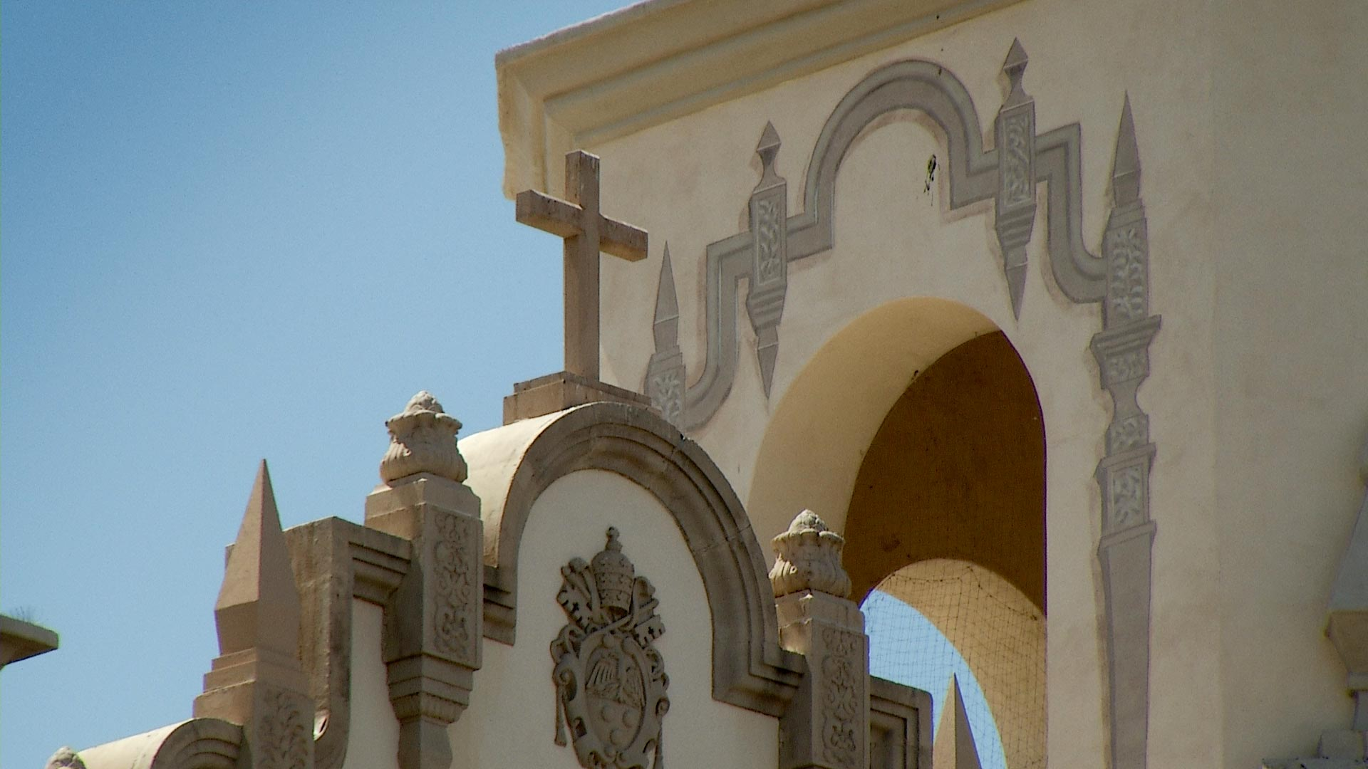 A cross atop the Saint Augustine Cathedral in Tucson, June 2017.