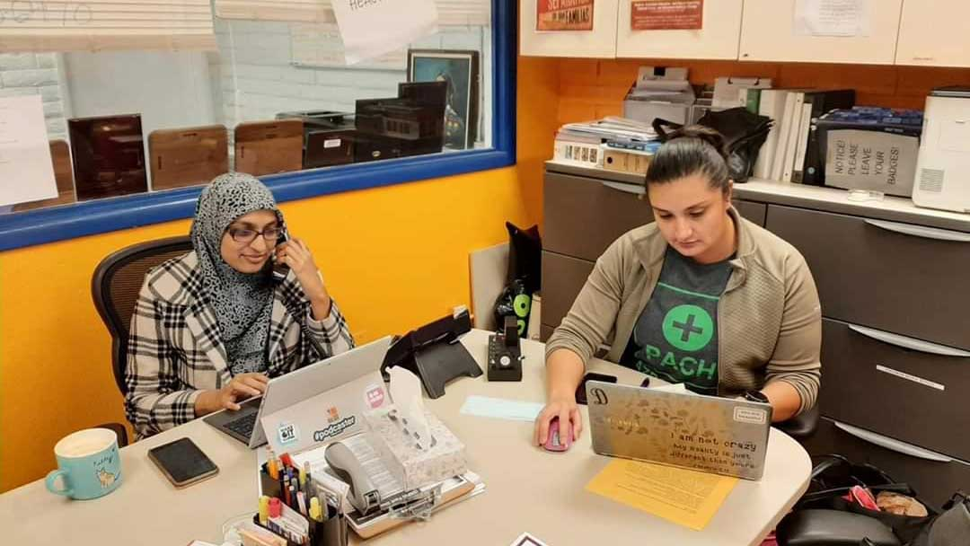 Director of Clinic Operations Dilia Ayala (right) does a telehealth appointment with Dr. Uzma Jafri. The all-volunteer staff at the Phoenix Allies for Community Health clinic serves people with limited access to care.