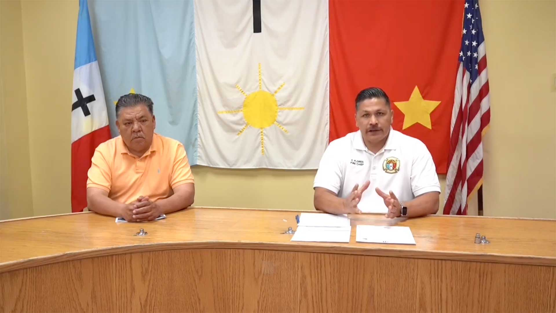 Pascua Yaqui Tribe Chairman Robert Valencia, left, and Carlos Flores, fire chief and COVID-19 emergency response coordinator, update the community on screening and testing opportunities in this still image from an April 17 Facebook video.