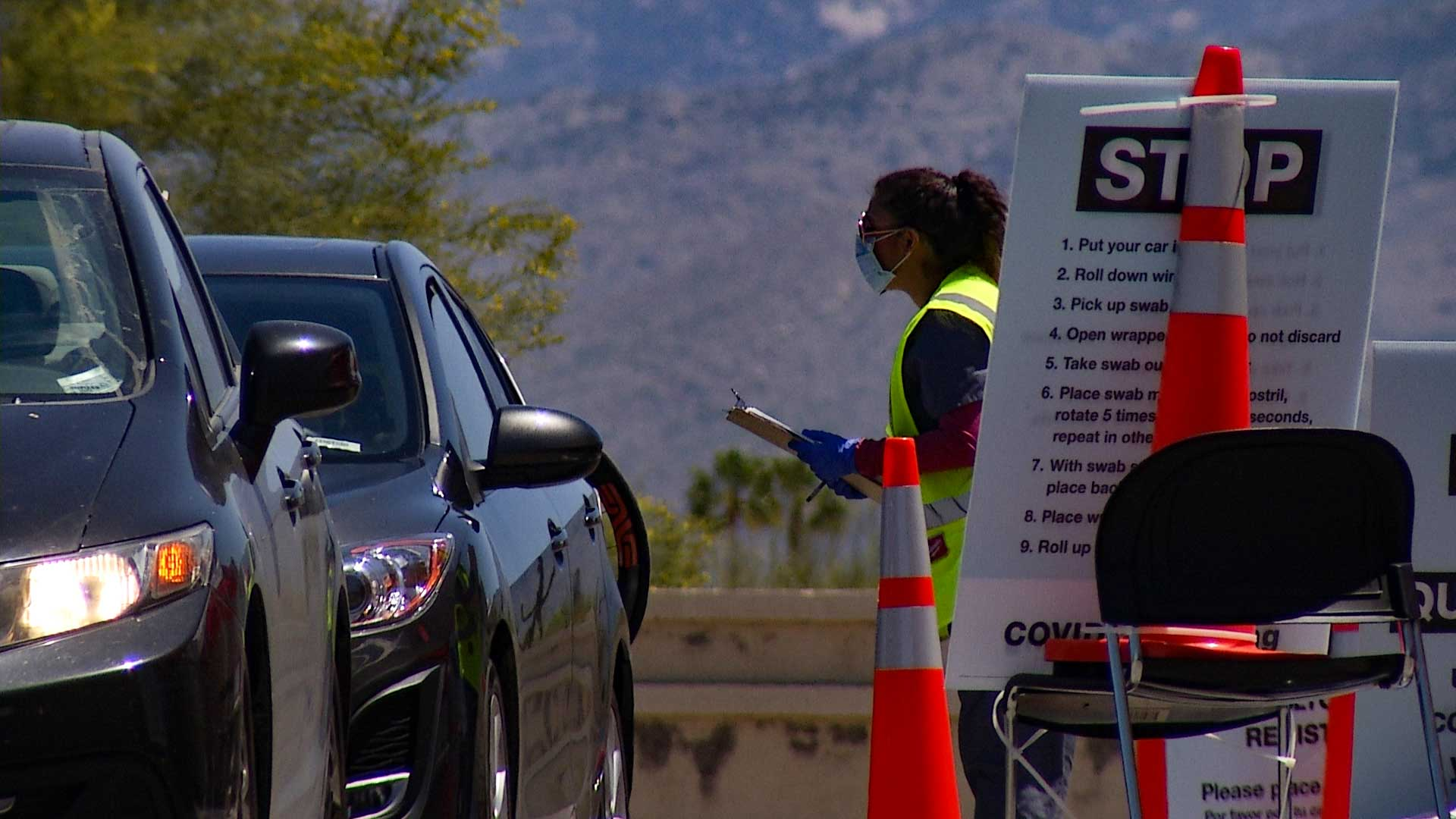 Drivers are screened at a Walgreens COVID-19 testing site in Tucson, April 21. Tucson was chosen as one of 15 locations nationwide for the expansion of drive-thru testing sites by Walgreens.
