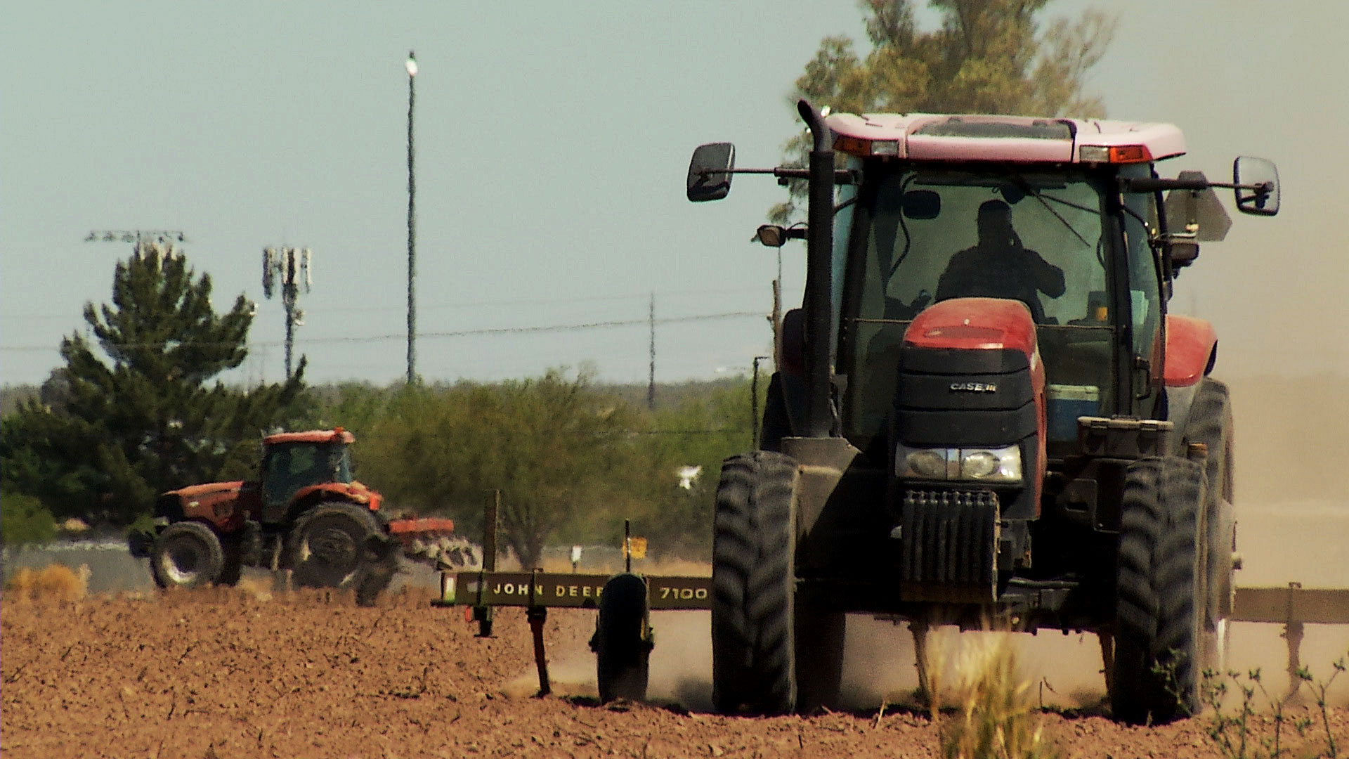 Tractors tend a cotton farm in Marana on April 22, 2020.
