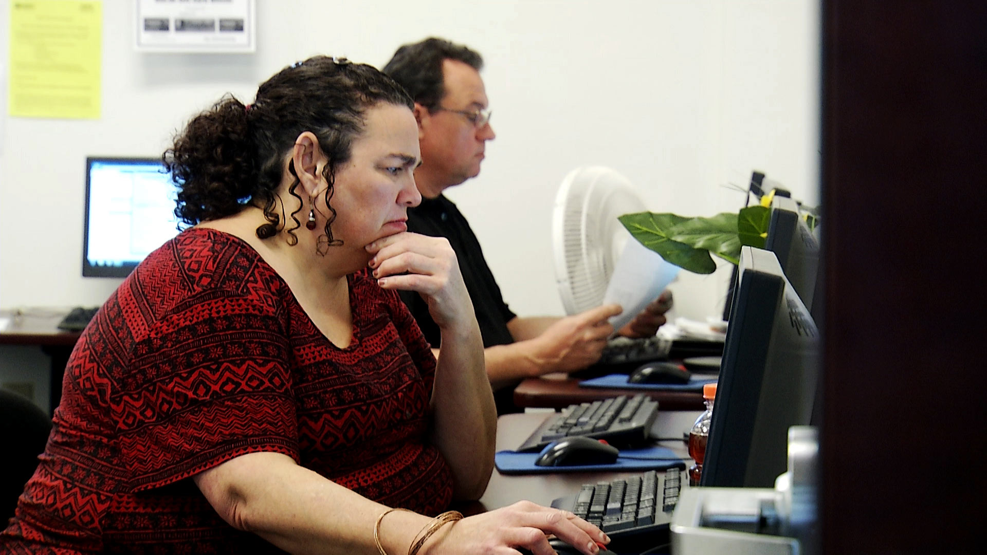 Undated image of a woman using a computer at a job connection center in Pima County.