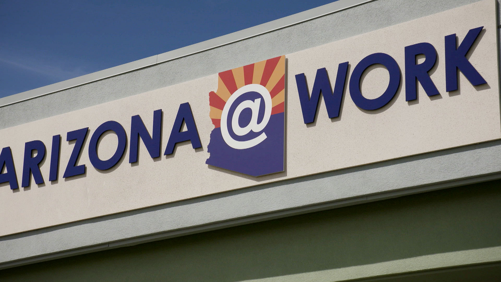 A closeup of signage for Arizona@Work and Department of Economic Security offices in Tucson.