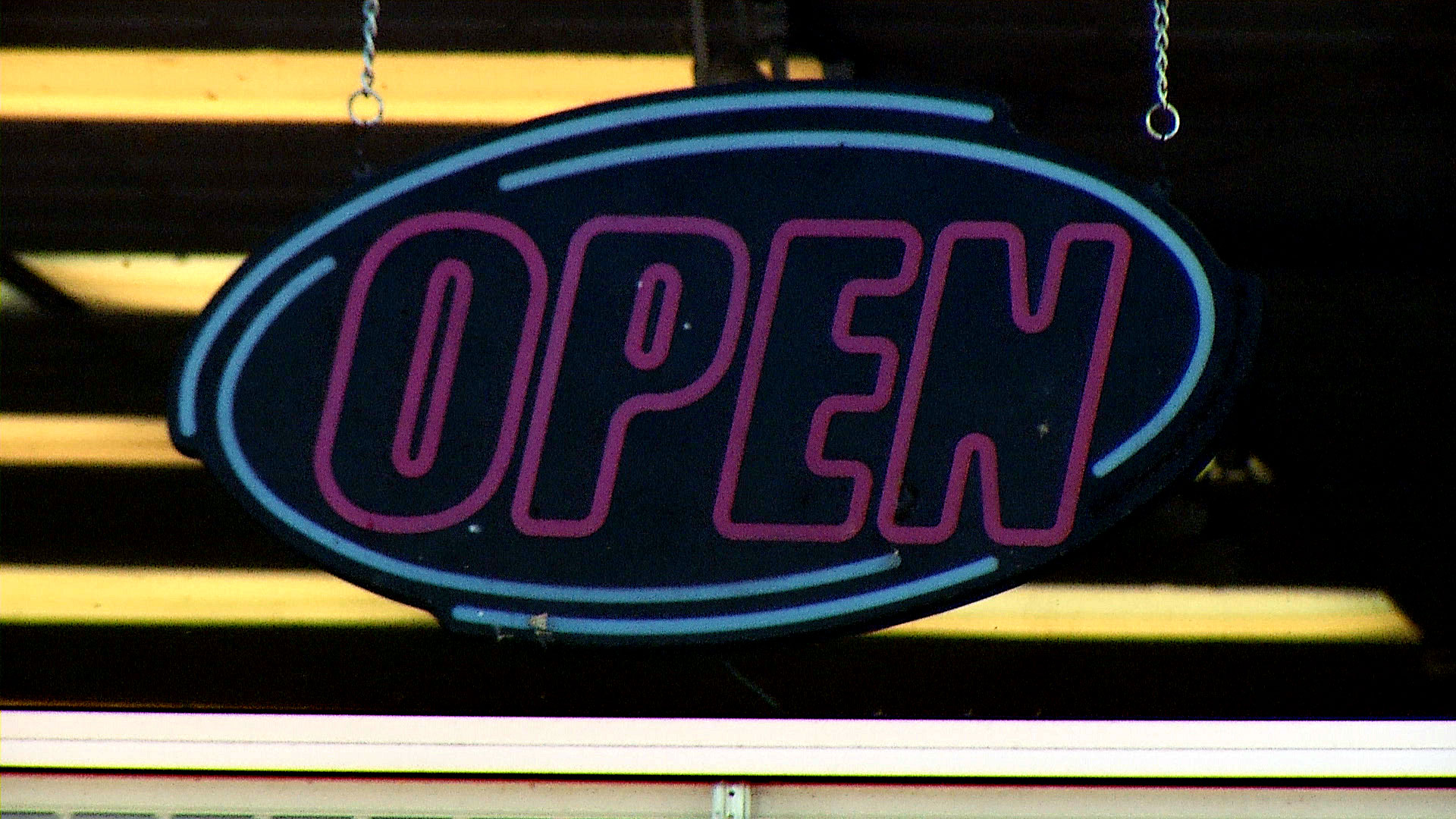 The open sign is illuminated in the window of Casa de Nails in South Tucson. The salon reopened once Gov. Doug Ducey eased COVID-19-related restrictions on hair stylists and nail salons.