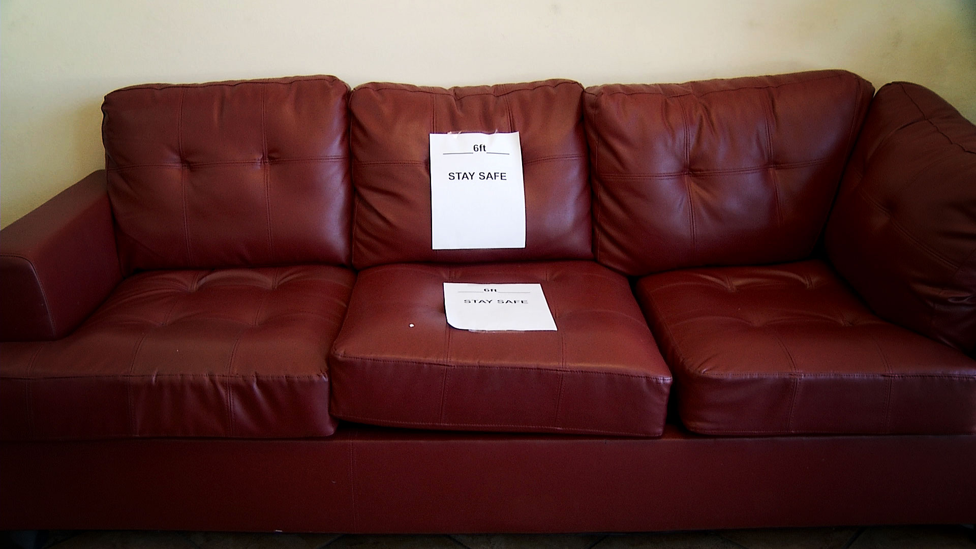 A note posted on a sofa at Eclips Cuts Salon in Tucson reminds guests to remain six feet apart while they wait. The salon reopened with added safety precautions designed to prevent the spread of coronavirus. May 12, 2020.