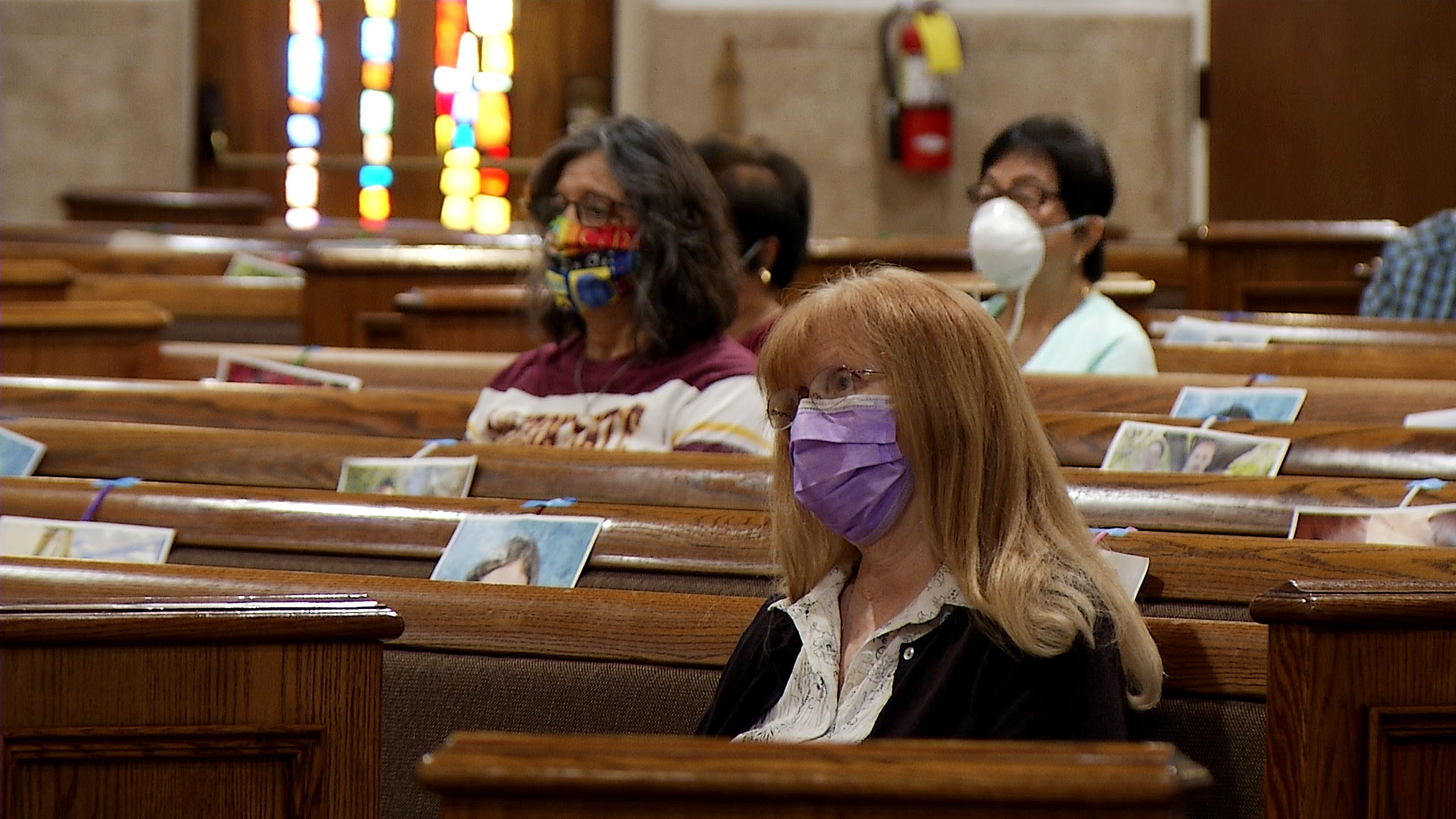 Parishioners attend mass at St. Mary's Church in Chandler on May 19, 2020. The Catholic Diocese of Phoenix gave pastors the option to resume public mass with limited capacity and face masks as added safety precautions. Photos of the congregation's members fastened to the pews indicate spaces where people cannot sit.