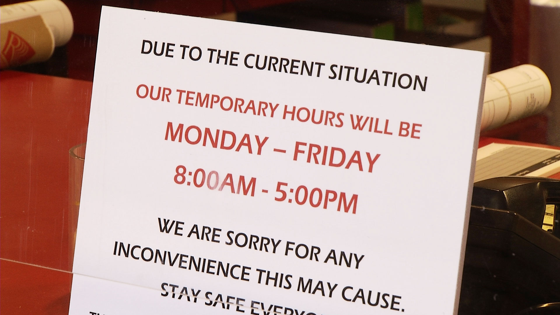 A sign at Reproduction, Inc. in Tucson notifies customers about the company's shortened hours. May 18, 2020.