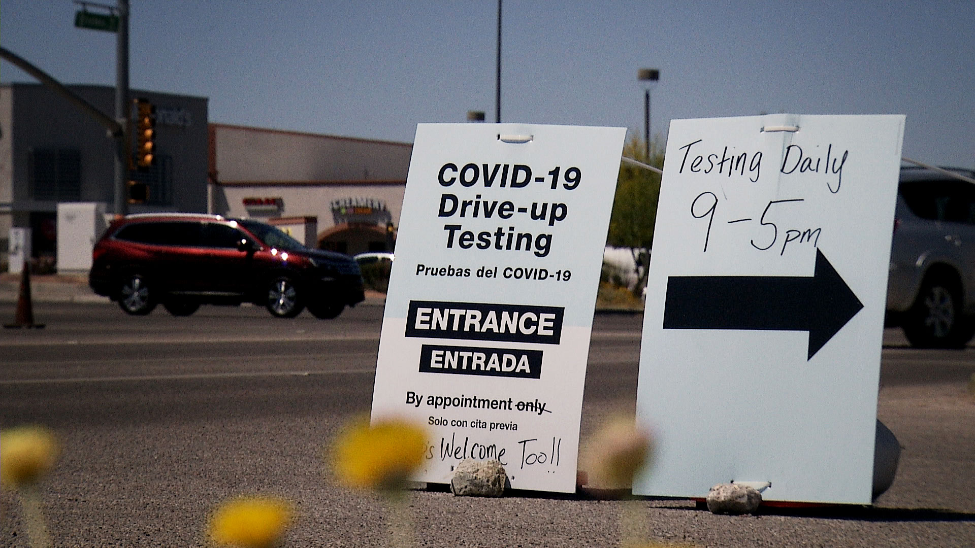 Signs advertise a drive-thru COVID-19 testing site outside of Walgreens in Tucson on April 21, 2020.