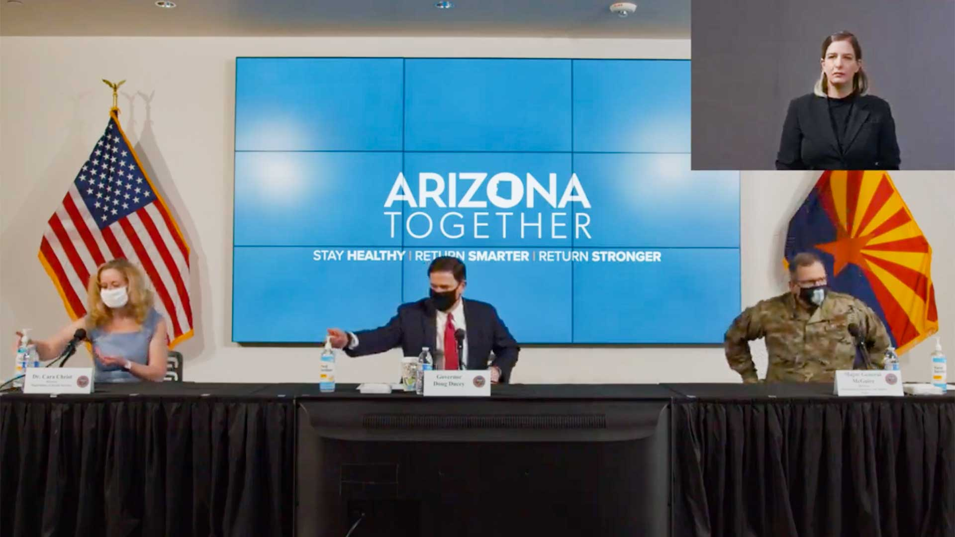 ADHS Director Cara Christ, Gov. Doug Ducey and Maj. Gen. Michael McGuire show up to a June 17 meeting wearing masks. They removed the masks after sitting down.