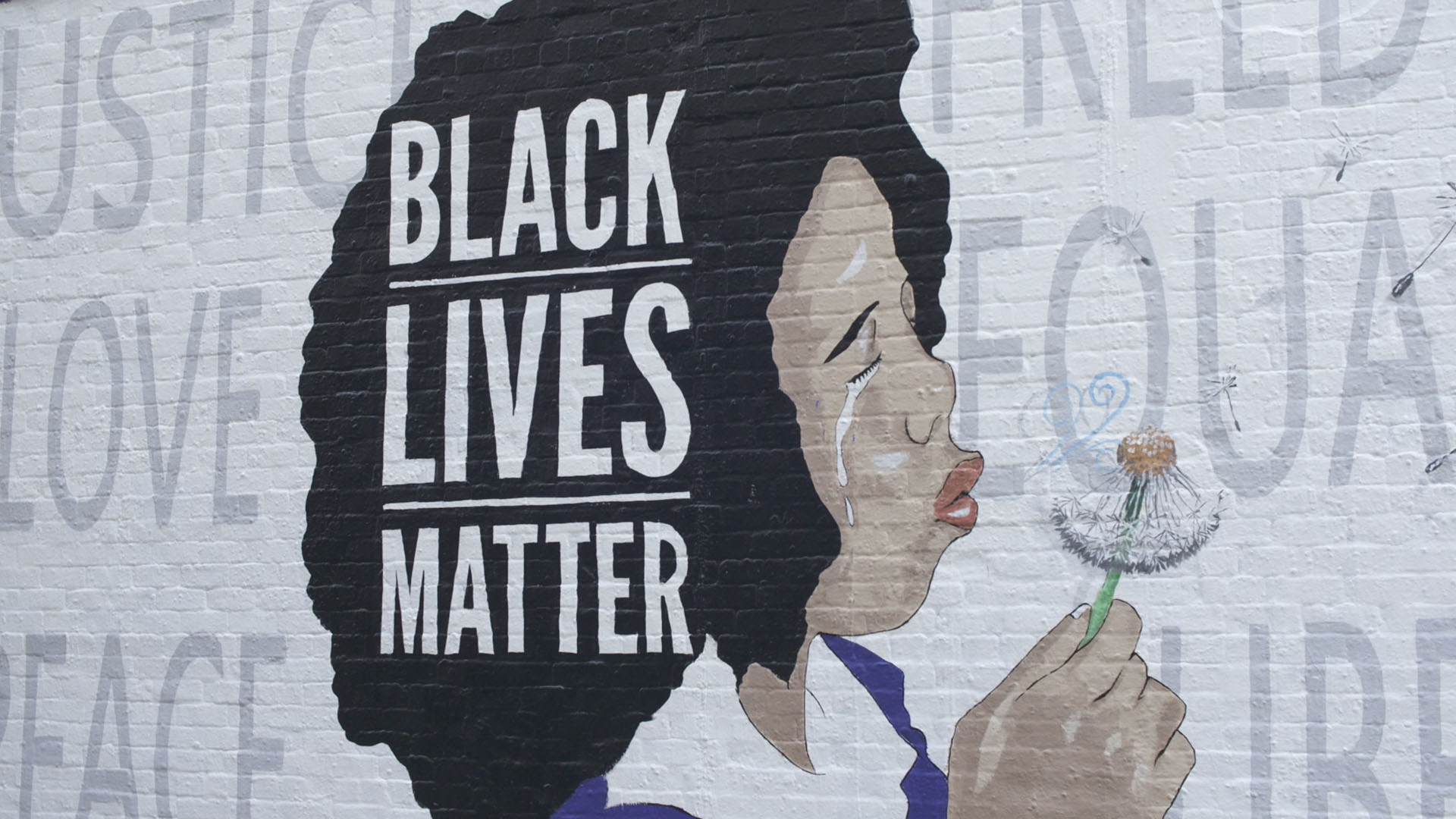 A Black Lives Matter mural painted by Robbie Lee Harris June 2020 at Tucson's Rialto Theatre.