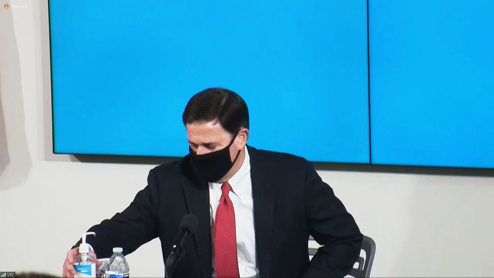 Arizona Gov. Doug Ducey wears a face mask during a news conference in Phoenix on June 18, 2020.