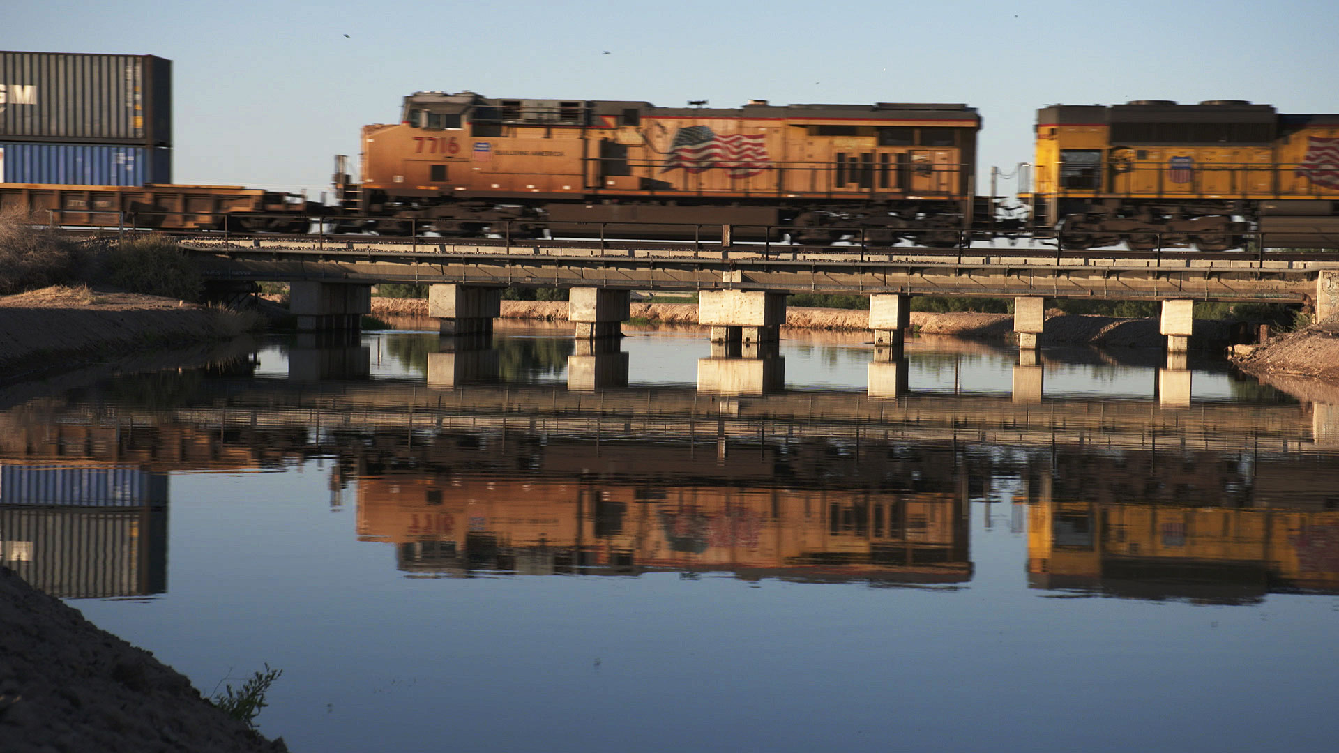 A train passes over the water in Cibola, Arizona. June 2020.