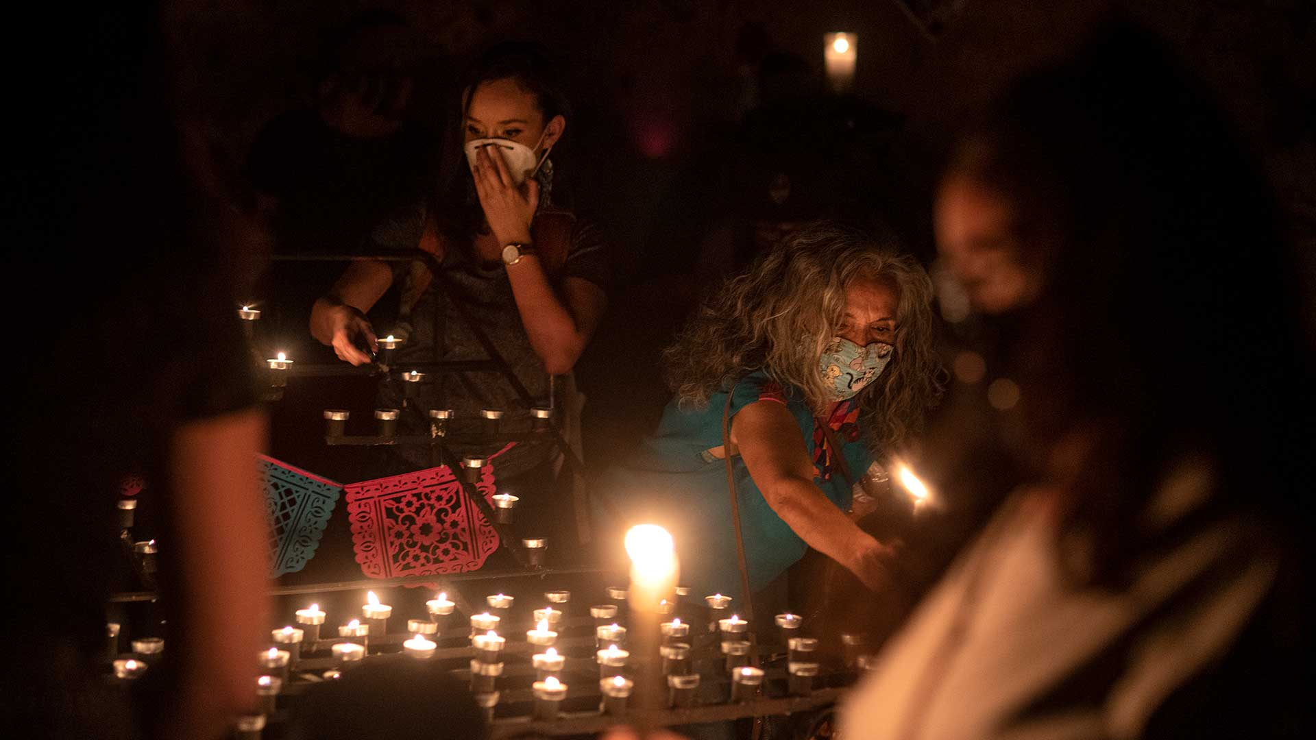 Community members and family of Carlos Adrian Ingram-Lopez light candles in his memory at the El Tiradito shrine on June 25, 2020.