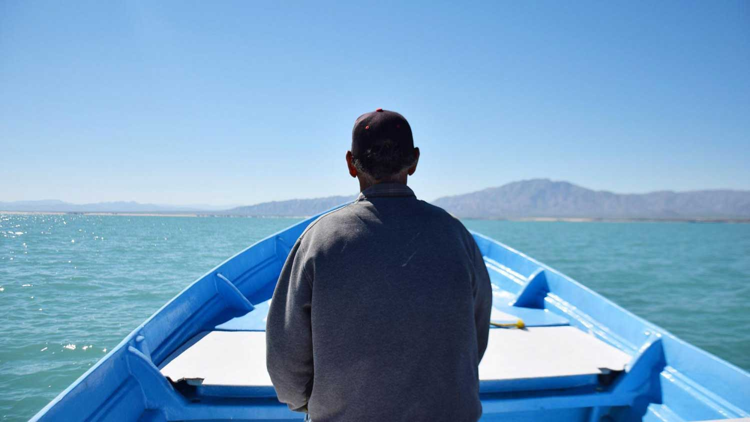 Fisherman Ruben Orozco sits in the front of his small boat, or panga, outside the town of San Felipe in October 2018.