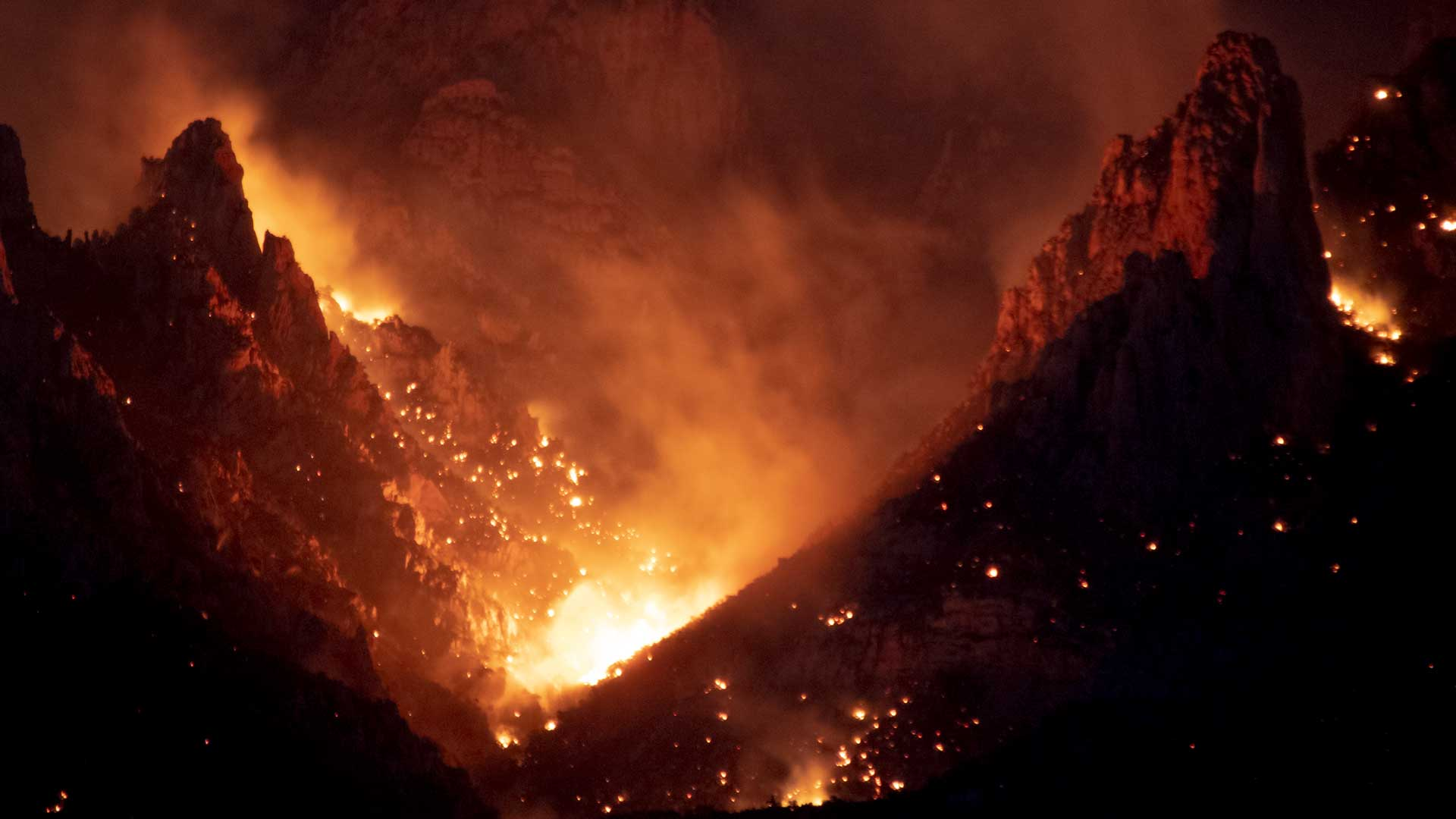 The Bighorn Fire burns in the Pusch Ridge Wilderness near Oro Valley on June 7, 2020.