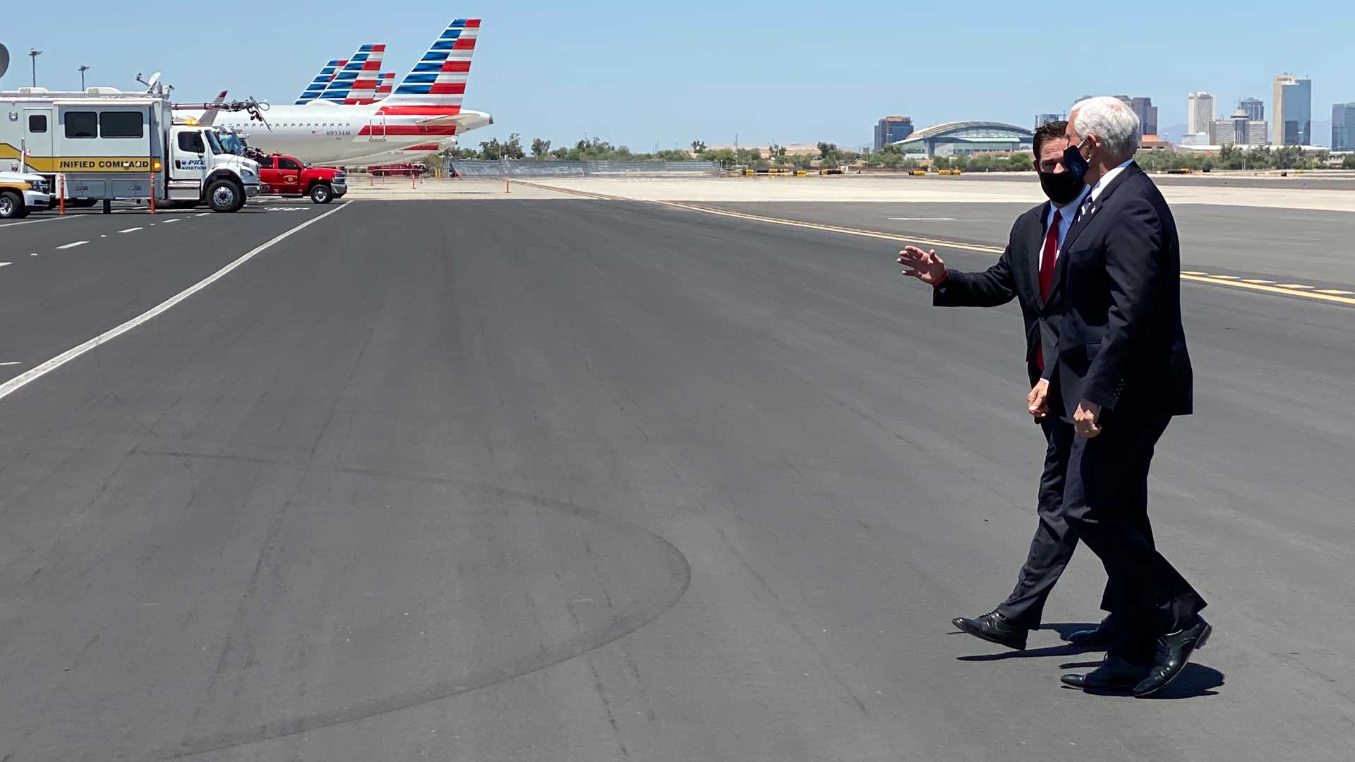 Gov. Doug Ducey greets Vice President Mike Pence on the tarmac in Phoenix.  Pence was in Arizona to discuss the state's response to the COVID-19 pandemic. July 1, 2020.