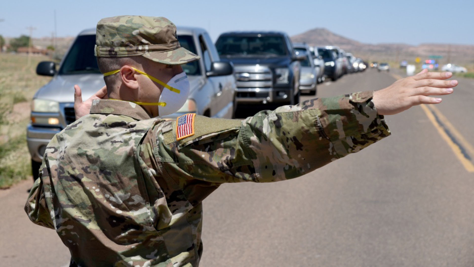 Arizona National Guard service member directs visitor traffic at COVID-19 testing site in Tonalea, Arizona, in the Navajo Nation May 19, 2020.