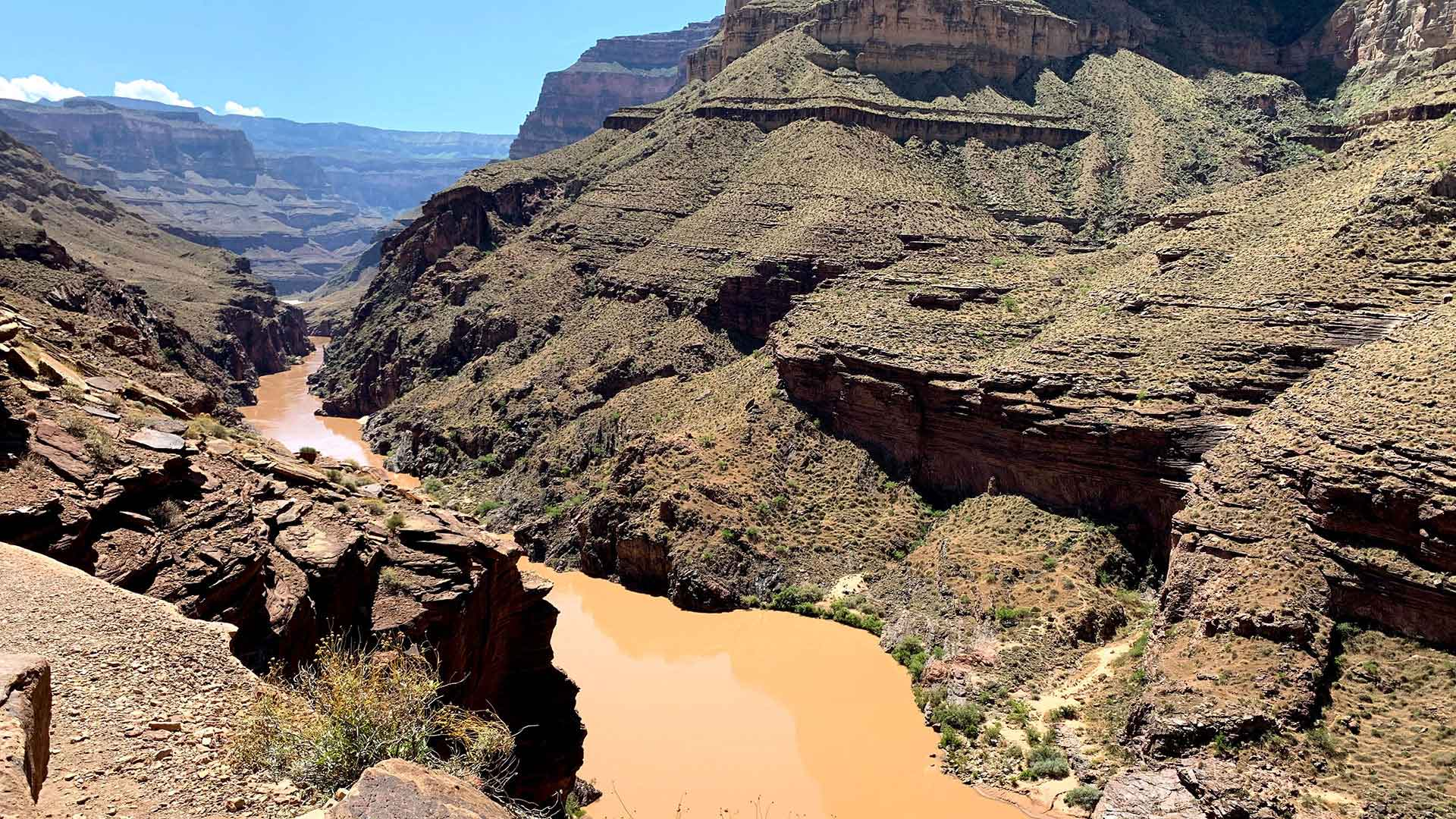 Scientists have been studying the Colorado River, shown here from above Deer Creek Falls, for nearly four decades to understand the environmental impacts of the Glen Canyon Dam on a water source used by around 40 million people in seven states. The environment, climate change, tribal rights and those water users will all be considered in river-management talks expected to begin later this year.
