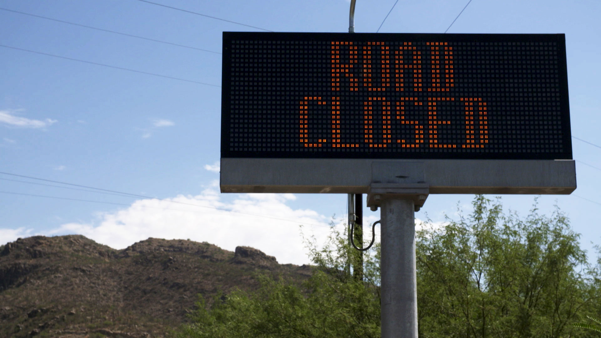 An electronic sign at the base of Catalina Highway lets traffic know the road is closed to visitors due to damage caused to guardrails by the Bighorn Fire on July 21, 2020.