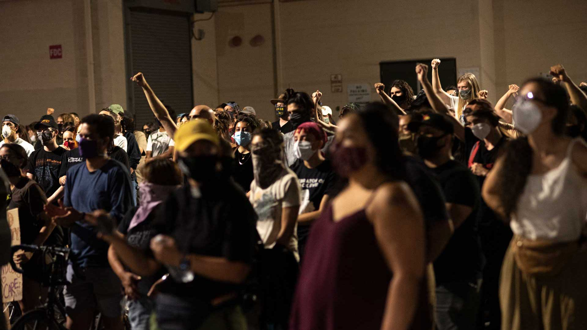 Protesters stand in front of a Tucson Police Department precinct in downtown Tucson on June 25, 2020.