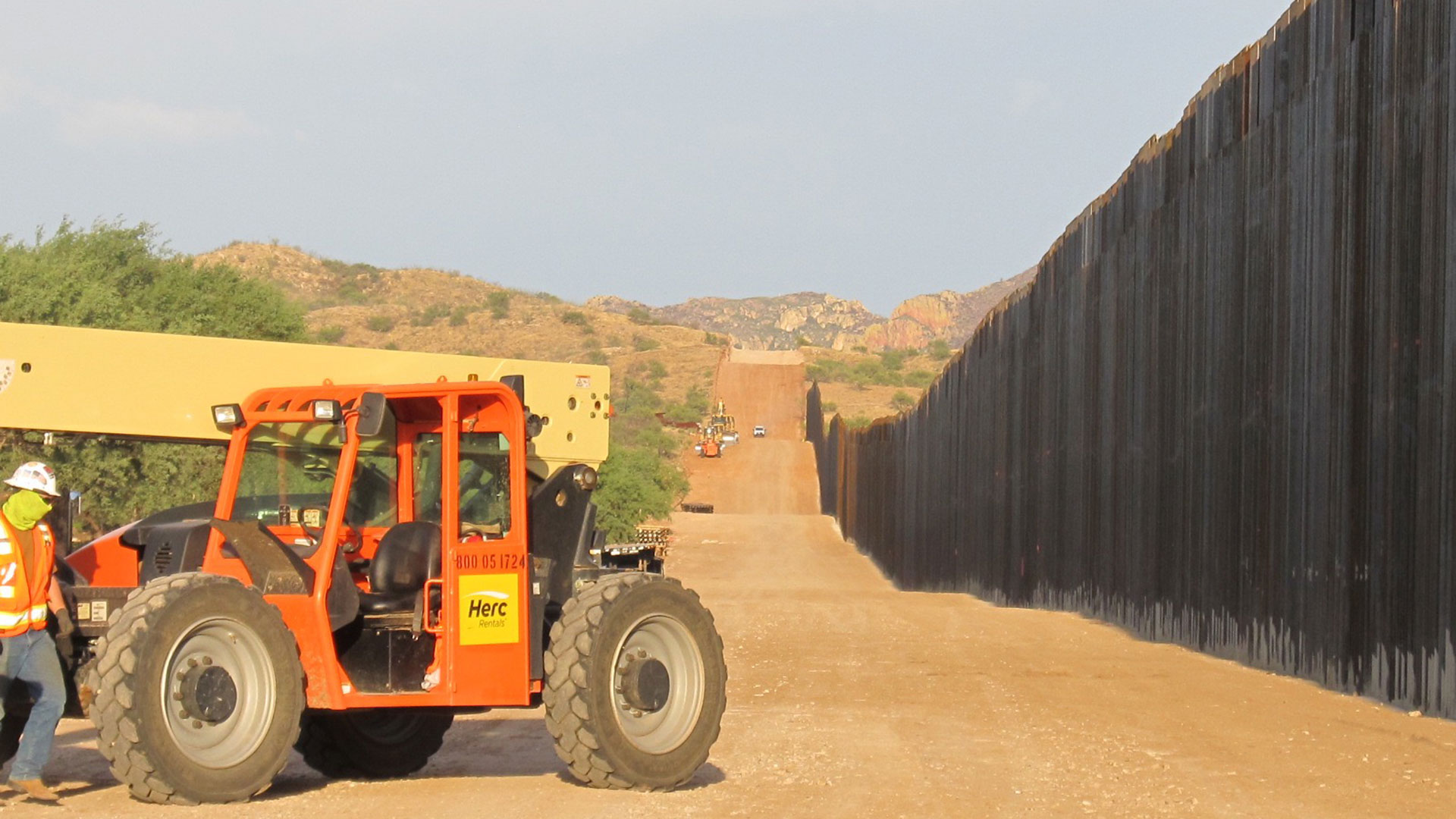 Construction of 30-foot high steel bollard wall on or near the Buenos Aires National Wildlife Refuge near Arivaca in July 2020.