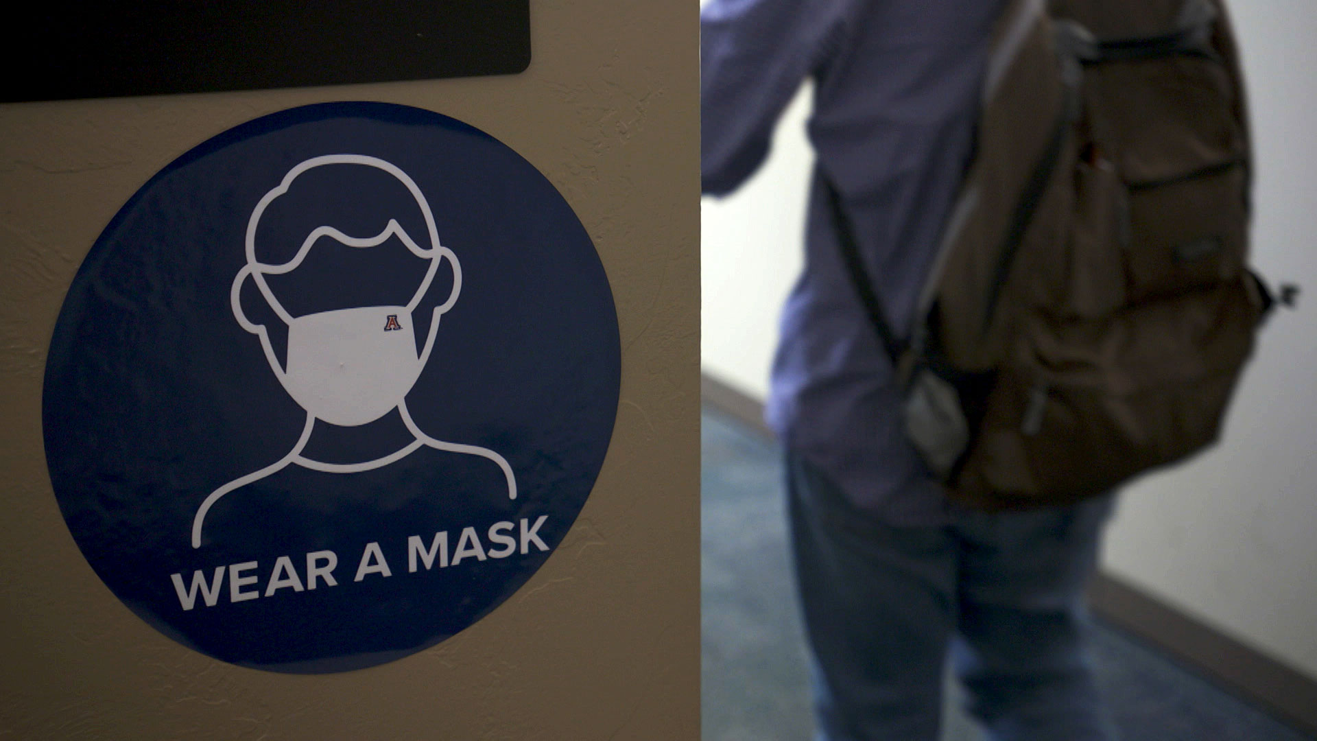 Signage inside a building at the University of Arizona promotes mask wearing on campus, July 2020.