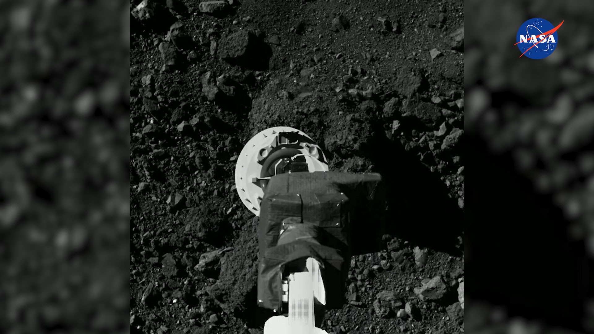 The OSIRIS-REx spacecraft hovers above the asteroid Bennu during a rehearsal on August 11, 2020, months ahead of a planned mission to collect a sample of the asteroid from its surface.