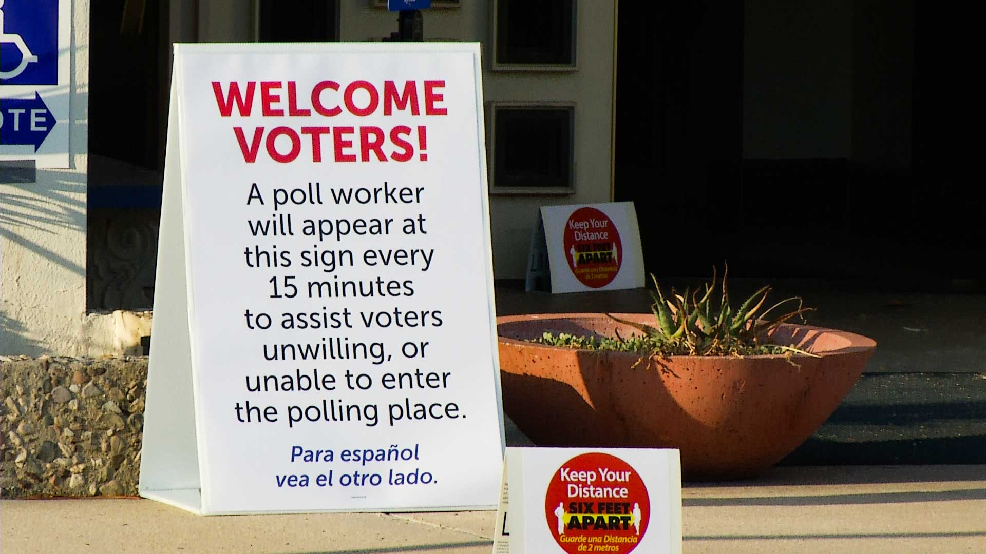 A sign instructs Pima County voters casting their ballots on primary election day, Aug. 4, 2020.