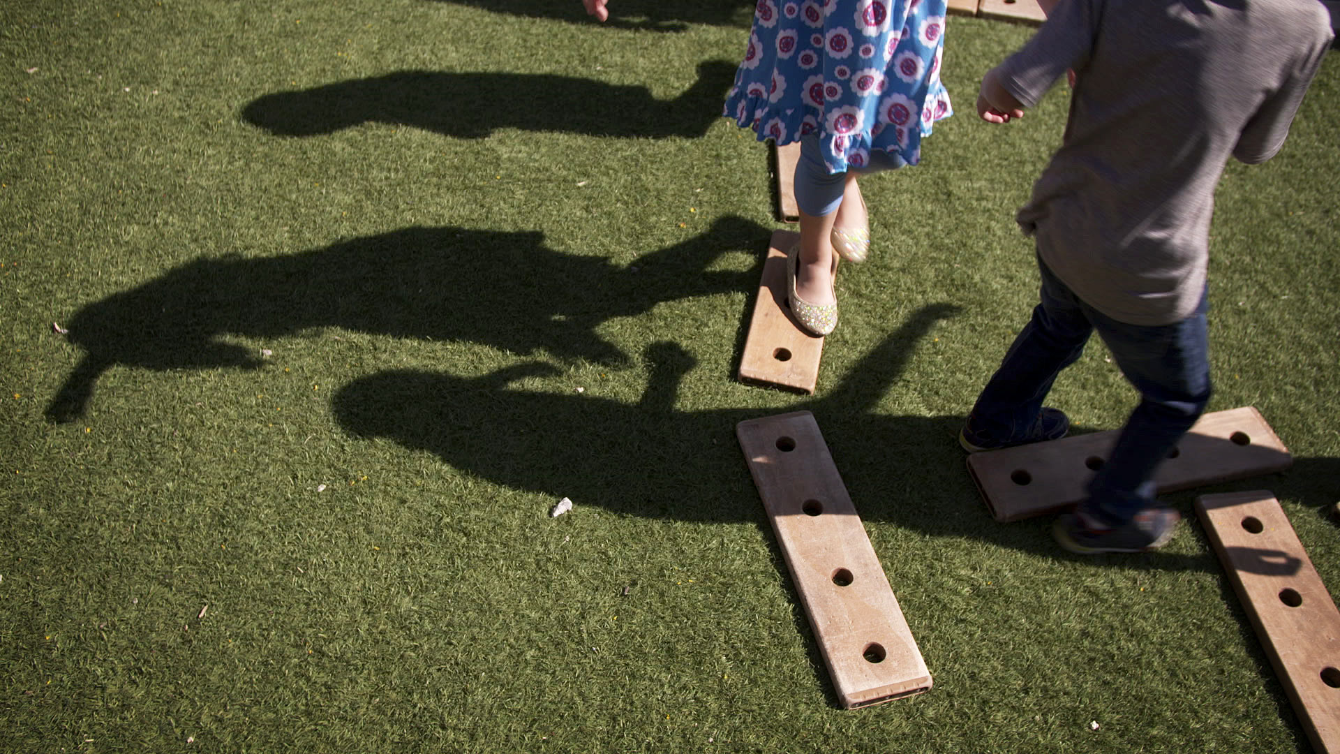 The shadows of children playing outside at a school in Tucson.