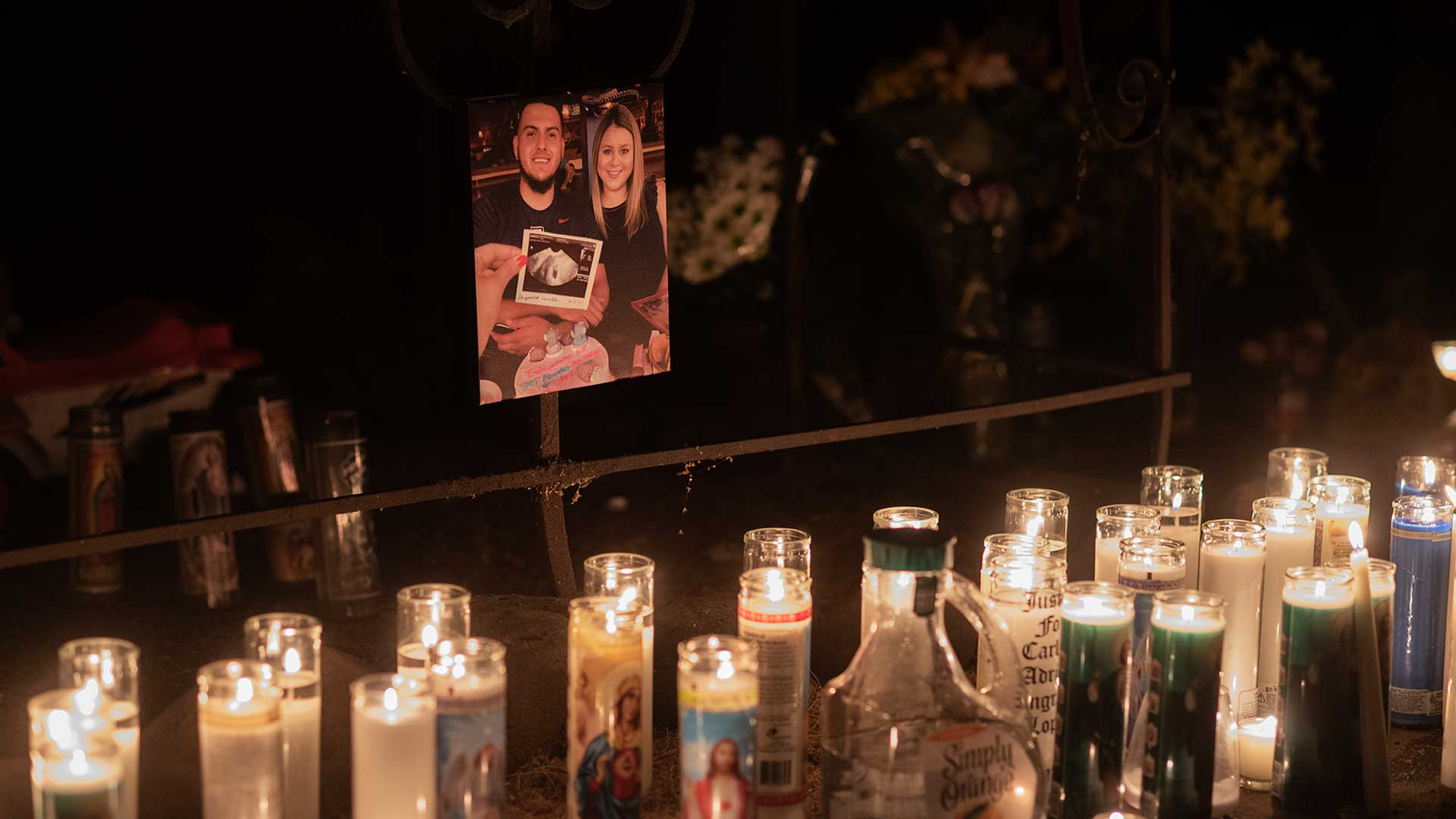 Candles encircle an image of Carlos Ingram-Lopez with his fiancé at the El Tiridito shrine.