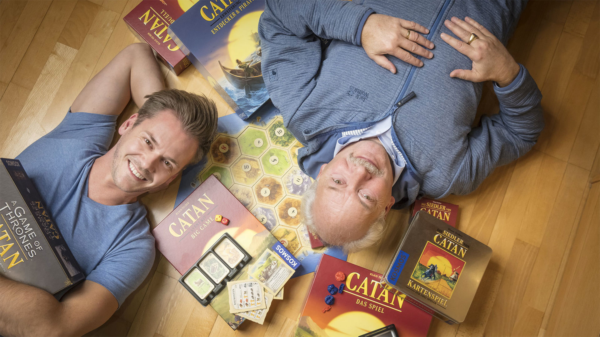 Klaus Teuber, creator of the popular board game Settlers of Catan, with his son Benjamin Teuber, managing director of Catan Inc. As families shelter in place, the game's sales have skyrocketed. Celebrates the 25th anniversary since launch, the elder Teuber has released an autobiography, My Way to Catan.