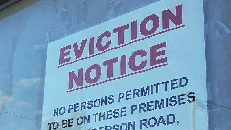Experts say signs like this one could become more common this fall, as state and national moratoriums on evictions in the face of COVID-19 are lifted. Arizona already has one of the highest rates of housing losses in the nation, a new report says.