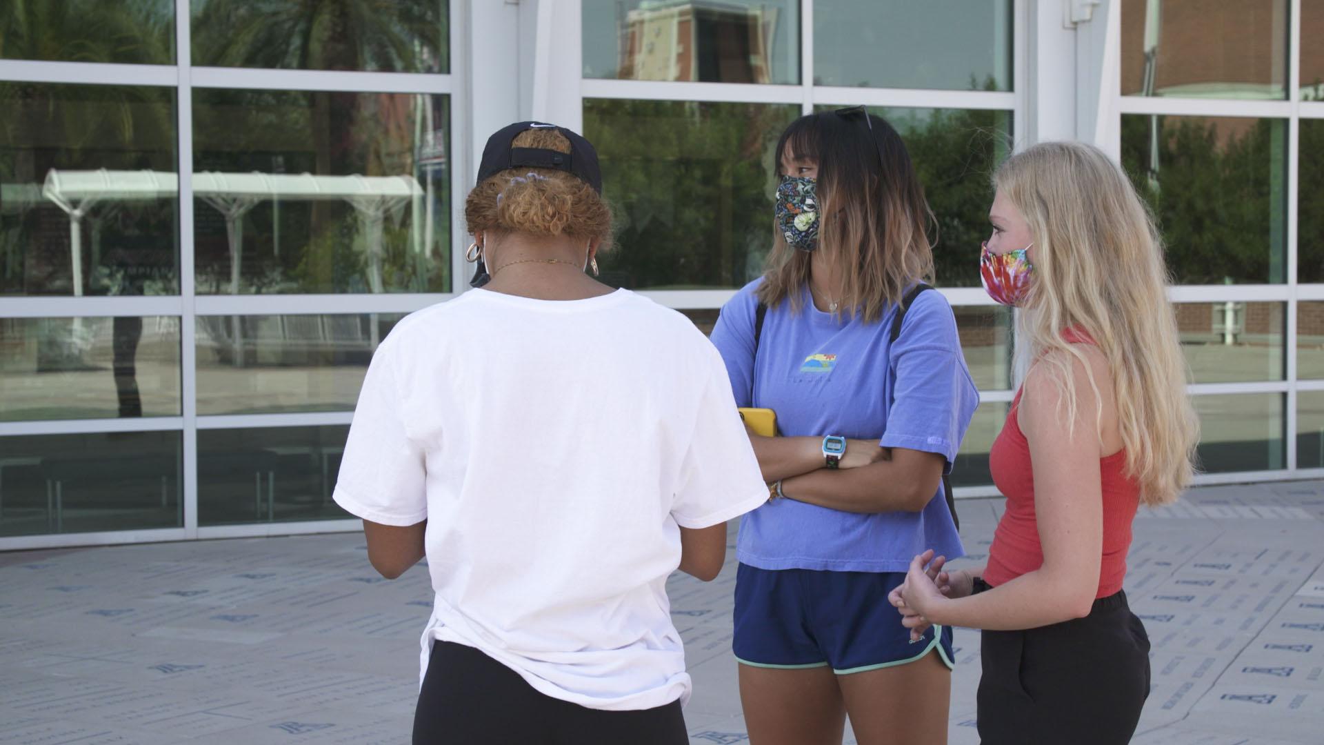 University of Arizona students wearing masks on campus.