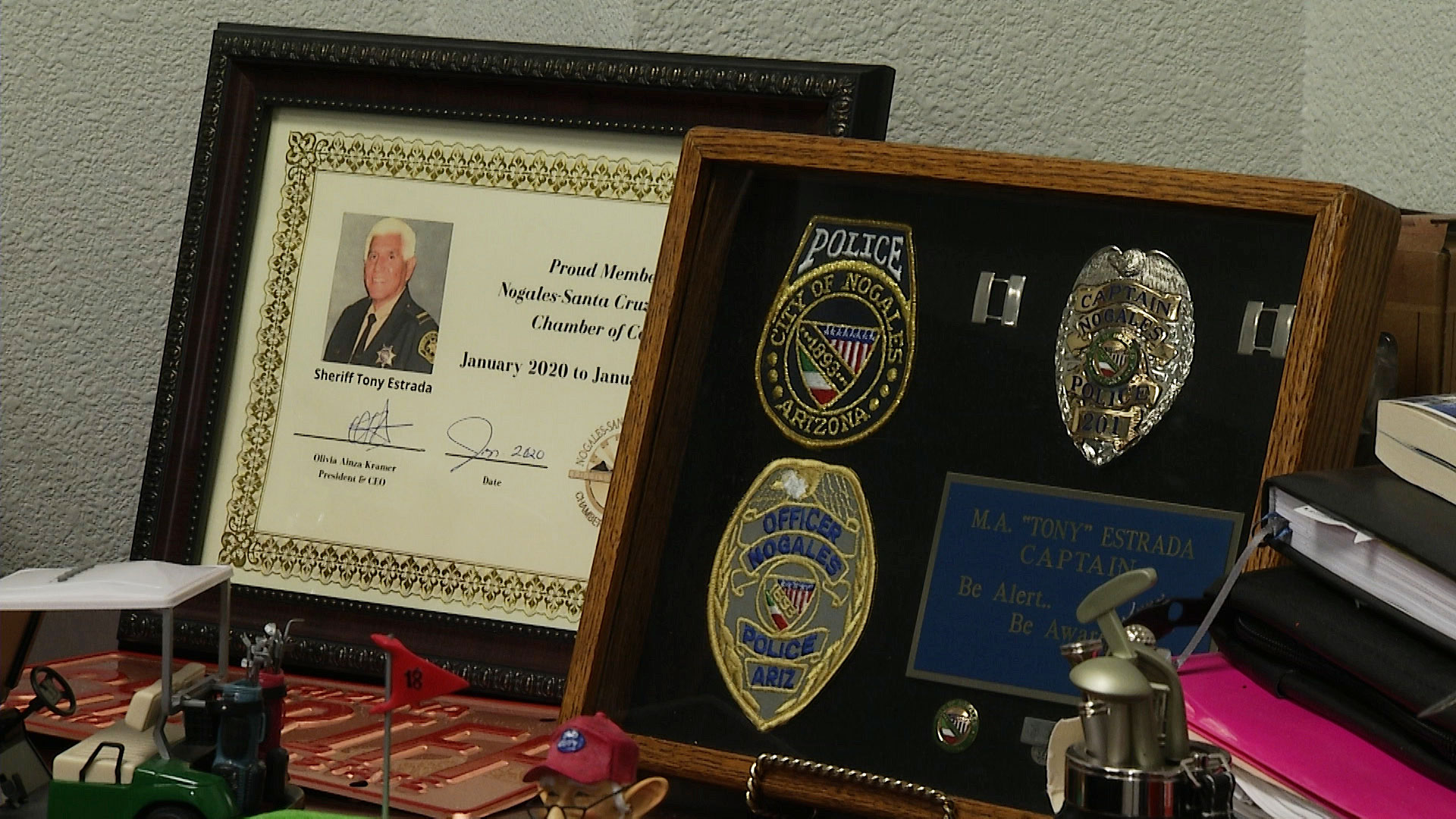 Framed keepsakes and police memorabilia adorn Santa Cruz County Sheriff Tony Estrada's office.