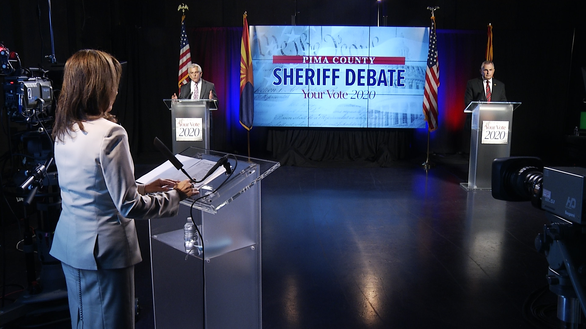 (From left to right) Arizona 360 host Lorraine Rivera moderates a debate in the race for Pima County sheriff between Democratic challenger Chris Nanos and Republican incumbent Mark Napier on September 21, 2020 at Arizona Public Media.
