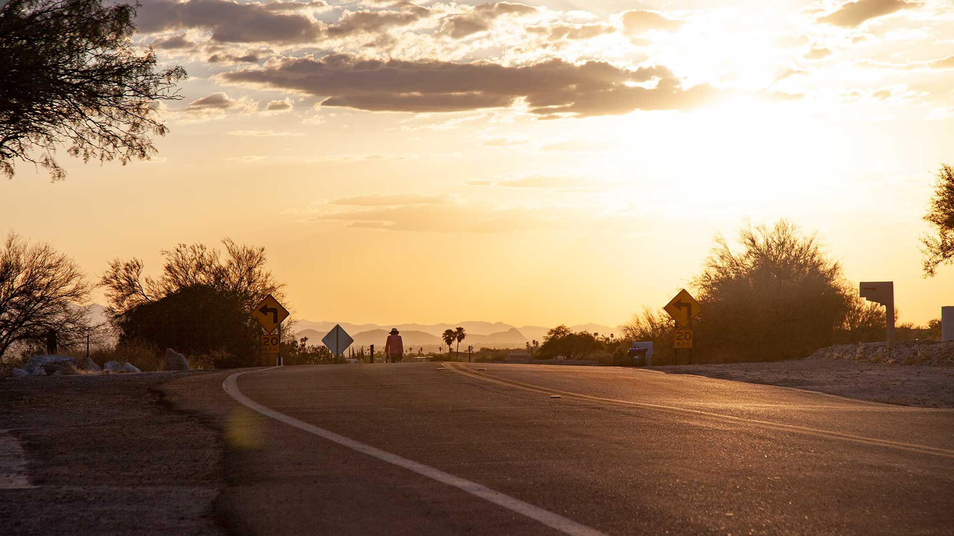 The sun sets over Tucson in July 2020, which was the hottest July on record.