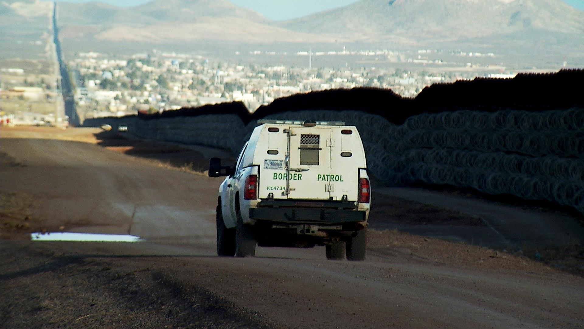 A border patrol vehicle drives along the border wall in Douglas, Ariz. January 2021.