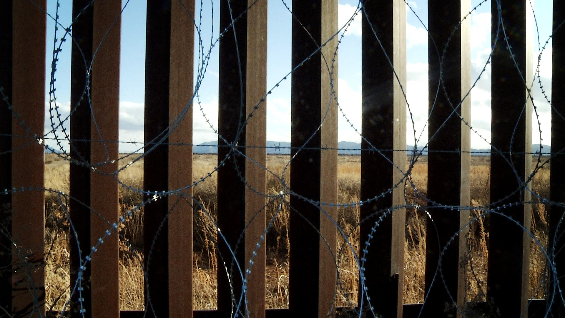 Border wall fencing with concertina wire attached in Douglas, Ariz. January 2021.