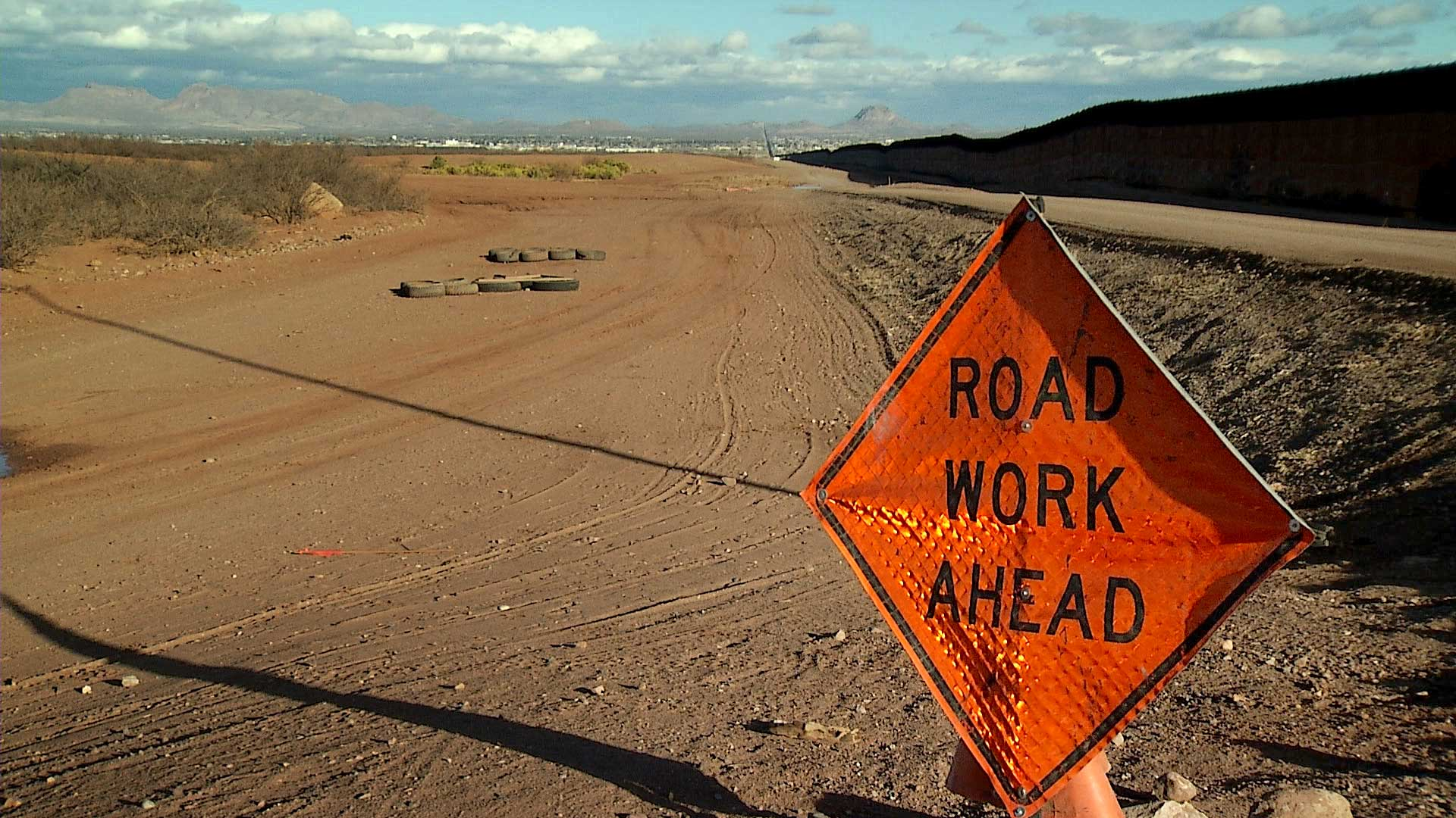 A sign indicates road work ahead along the border wall in Douglas, Ariz. January 2021.
